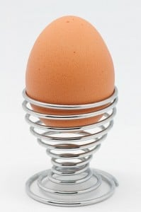 Modern Spiral Eggcup, with egg. This image represents EggCup Web Design.