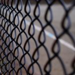 Chain link fence, symbolising hyperlinks.